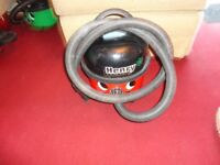 henry hoover red and black with pipe in good working order