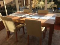 Extending dining table & 4 cream chairs