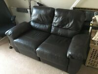 Brown leather 2-seater sofa with extendin footrest
