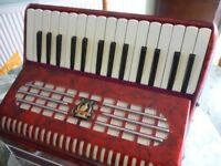 beautiful red pearscent parrot quality accordian with straps & original case,excellent condition....