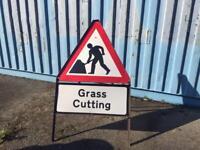 Grass cutting sign