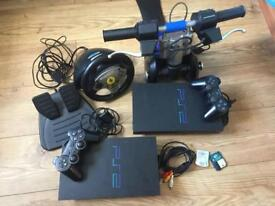 2xPlaystation 2 ,2controllers, Thrustmaster Freestyler Bike handle,Steering Wheel,Pedals,games