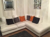 White leather corner group Couch and Pouffe. From a pet and smoke free home.
