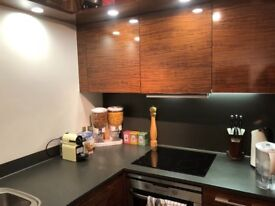 Used kitchen with worktops and sink