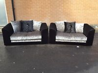 Lovely 1 month old black& silver crushed velvet sofa suite.pair of 2 seater sofas.delivery available