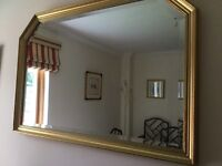 Mirror with gold coloured surround