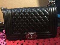 Chanel Classic Le boy handbag in black with metal chain