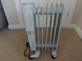 Beldray Oil Filled Radiator 7 fin 1500W (grey). Bought last year so in great condition!