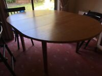 Dining table extendable in solid wood