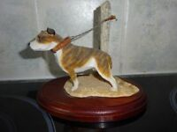 Ornament of Staffordshire bull terrier on lead