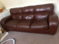 Large brown three seater leather sofa. Excellent condition. Has hardly been sat on.