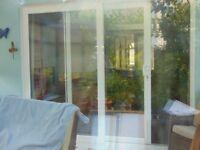 Used sliding patio door set - white uPVC frame. Change in availability.