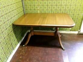 SOLID WOOD EXTENDING DINING TABLE EXC.COND.