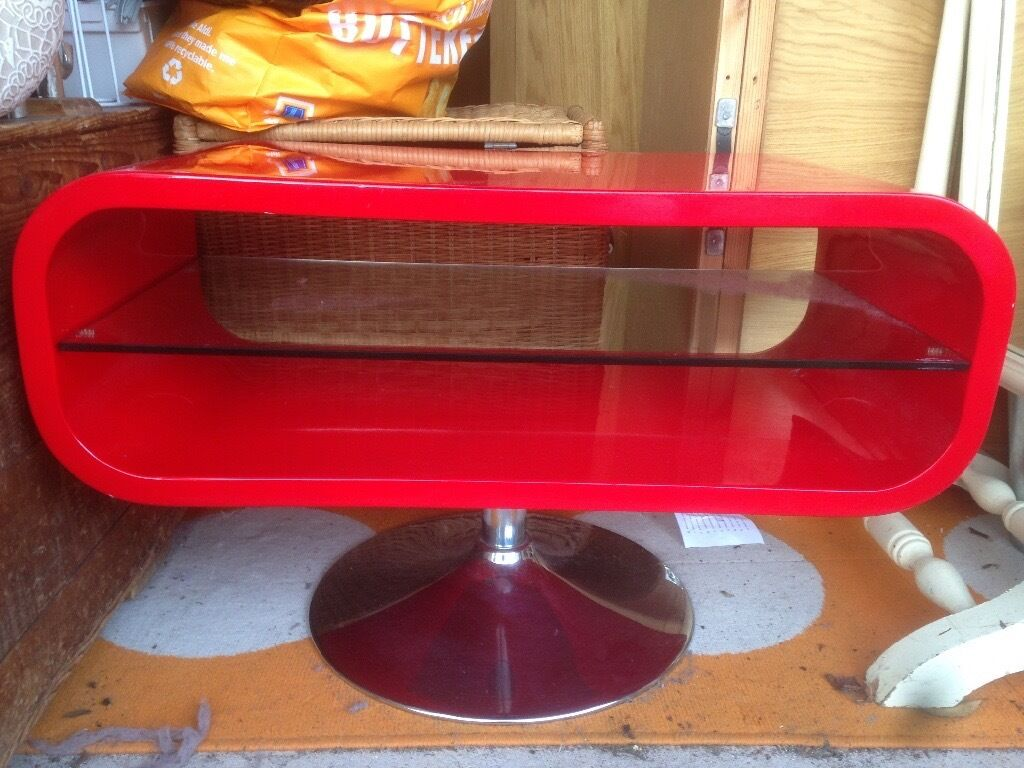 Red tv stand with glass shelf, excellent condition. £20