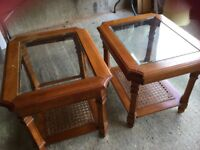 2 matching sofa/side tables with glass tops and wicker shelf.
