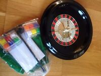 Roulette wheel with chips, green baize and instructions on how to play