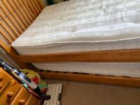 Two single beds, one stows under the other
