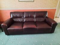Burgundy leather 3 seater and 2 seater suite