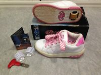 Heelys UK size 1/2 or 34 EUR. White with pink trim. In good condition in original box.