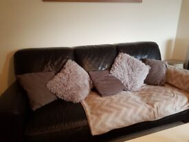 brown/black faux leather sofa from smoke and pet free home