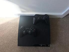 PS3 Slim with 2 controllers & 20 games!