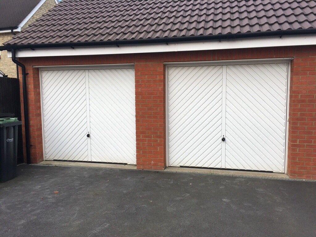 White metal, up and over garage door