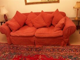 LARGE RED SOFA WITH SCATTER CUSHIONS