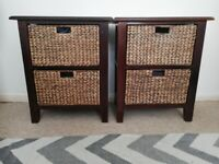 Yes still available. Two wood frame wicker basket draw storage units. Still Available. :)