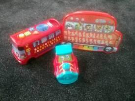 children's toys phonics bus, leapfrog touch magic and an elc wibble wobble train.