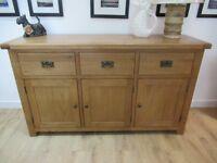 Elegant 3 door 3 drawer Sideboard. Constructed from solid oak, veneers and pine Sideboard.