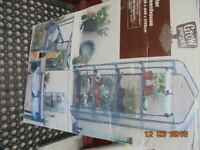 4 Shelf Greenhouse in unopened box with spare heavy duty cover