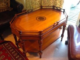 Captain's coffee table with inlay detail and shelf.