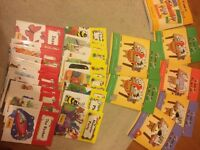 Jolly Phonics Extra Teacher's Book, Pupil's Book, and 33 Story Books for reading English.