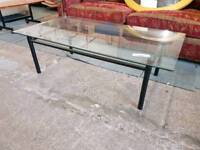 Glass topped metal coffee table