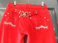Ladies red trousers with rhinestone trim on rear Size 14. New with labels attached.