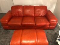 Orange leather sofa and pouffe