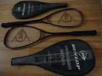 Two Dunlop squash racquets, each with a cover and both in excellent condition