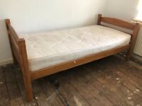 Single bed with wooden frame and mattress