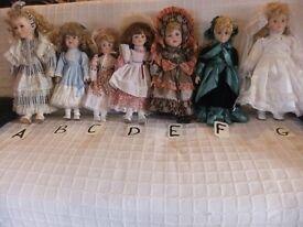 childs dolls, x 7