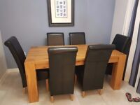 100% Chunky Solid Oak Dining Table with Six Black Chairs