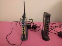 1 netgear and 1 linksys 4 port wireless N ADSL router