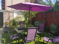Table ,chairs and wind up umbrella