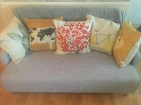 Fabric small two seater sofa.