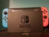 Neon nintendo switch with two games