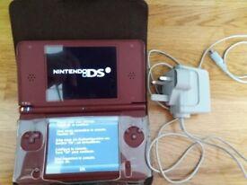 Nintendo DSi XL, case and games