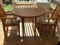 Round Table and Two High Back Carver Chairs £40