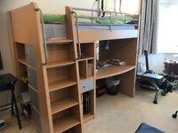 Bunk bed with desk and cabinets