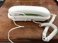 Corded wall mountable phone