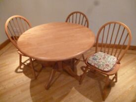 Pine table and four matching chairs all in good condition.