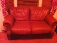 Free Brown leather studded sofa